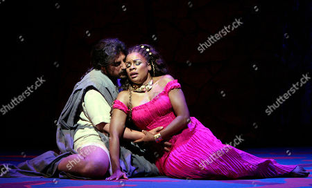 """Samson, played by Argentine tenor Jose Cura, sings alongside Dalila, played by mezzo-soprano Denyce Graves during a dress rehearsal of the Saint-Saens' opera """"Samson et Dalila"""" at the Metropolitan Opera in New York"""