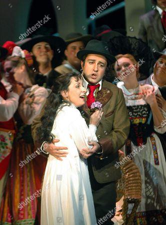 MUKERIA Singers Natalie Dessay, left, who plays Amina, and Shalva Mukeria, right, who plays Elvino, sing during a dress rehearsal of La Sonnambula at the Santa Fe Opera in Santa Fe, NM on