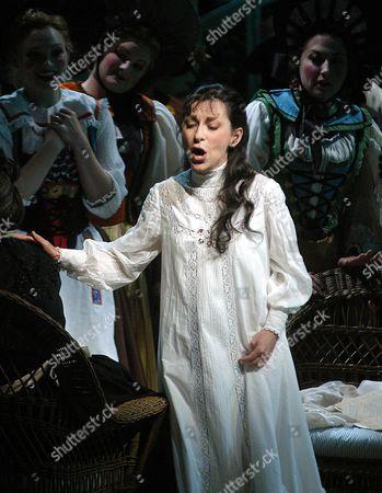 "NATALIE DESSAY Singer Natalie Dessay, who plays Amina, performs during a dress rehearsal of ""La Sonnambula,"" at the Santa Fe Opera in Santa Fe, NM"