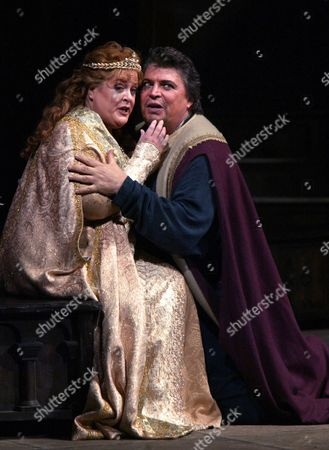 """Deborah Voigt as Elisabeth and Peter Seiffert as Tannhaeuser during rehearsal of the Metropolitan Opera's production of """"Tannhaeuser"""" in New York, . Seiffert made his Met debut in the role The production Thursday night, Nov. 18, 2004"""