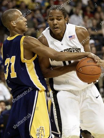ELLIS ROBERTS Wake Forest's Chris Ellis has the ball knocked away by North Carolina A&T's Greg Roberts (31) during the first half, in Winston-Salem, N.C