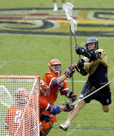HORN Navy's Ben Horn, right, leaps up to score a goal against Syracuse's Dan DiPietro (6) and goalie Jay Pfeifer during the fourth quarter of Syracuse's14-13 win in the division one NCAA Lacrosse Championship, in Baltimore