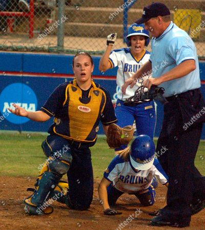 SIMPSON HENRY WOODS UCLA's Amanda Simpson, rear, cheers while California catcher Haley Woods looks around after UCLA's Tara Henry, on ground, scored, during the championship game in the Women's College World Series in Oklahoma City. Henry was called safe on a catcher interference call