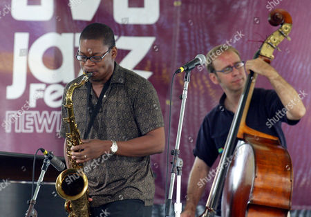 COLTRANE GRESS Saxophonist Ravi Coltrane, son of jazz legend John Coltrane, performs with his quartet's bass player Drew Gress at the Newport Jazz Festival in Newport, R.I