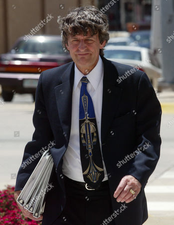 WALLACE Creekmore Wallace, one of the defense attorneys for convicted Oklahoma City bombing conspirator Terry Nichols, walks back to the courthouse following a break in the sentencing phase of Nichol's trial on state murder charges, in McAlester, Okla