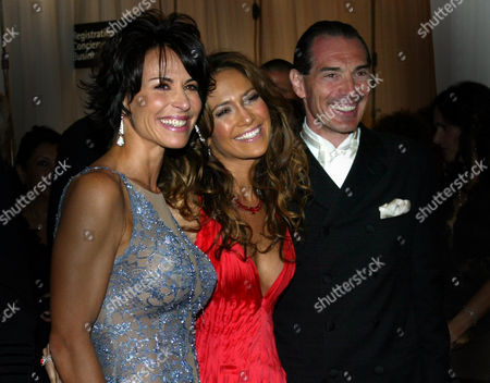 """YEMENIDJIAN Jennifer Lopez, center, poses for photographs with Giselle Fernandez-Farrand, left, who produced the event """"Noche de Ninos,"""" a benefit for Children's Hospital Los Angeles, and Alex Yemenidjian, event host and chairman and CEO of Metro-Goldyn-Mayer, at """"Noche de Ninos,"""", in Beverly Hills, Calif. Lopez was there to receive an award for her humanitarian efforts on behalf of children's Hospital Los Angeles"""
