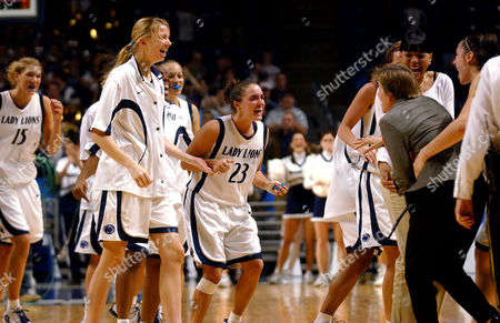 BROWN STROM Penn State's Amanda Brown (15), Jess Strom (23) and the rest of the team rush to congratulate associate head coach Annie Troyan following the team's 77-71 upset victory against No. 2 North Carolina, in State College, Pa