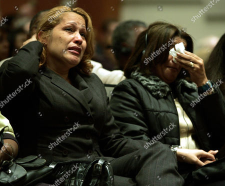 ORTIZ ZABALA Family members of victims of the crash of American Airlines Flight 587 Olivia Ortiz, left, and Ana Zabala, right, from New York City, react as they attend the meeting of the National Transportation Safety Board (NTSB) in Washington. The co-pilot of American Airlines Flight 587 caused the November 2001 crash that claimed the lives of 265 people, the staff of the nation's airline safety agency reported Tuesday