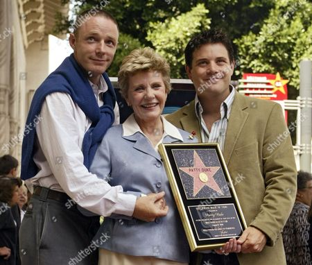ASTIN DUKE ASTIN Academy Award winner, and television actress Patty Duke poses with her sons, actors Mackenzie Astin, left, and Sean Astin after being honored with a star on the Hollywood Walk of Fame in Los Angeles. Duke, who won an Oscar as a child at the start of an acting career that continued through her adulthood, died, of sepsis from a ruptured intestine. She was 69