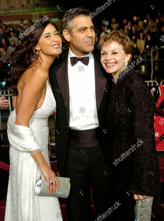 """Cast member George Clooney, center, arrives with Brittish actress Lisa Snowden, left, and his mother Nina Warren Clooney for the premiere of """"Ocean's Twelve,"""" at the Grauman's Chinese Theatre in the Hollywood section of Los Angeles"""