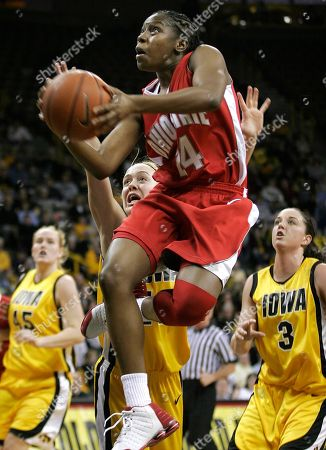 ALLEN KASPEREK ARMSTRONG Ohio State's Ashley Allen, center, drives to the basket past Iowa's Morgan Kasperek, left, Jenna Armstrong, rear, and Abby Emmert, right, during the first half, in Iowa City, Iowa