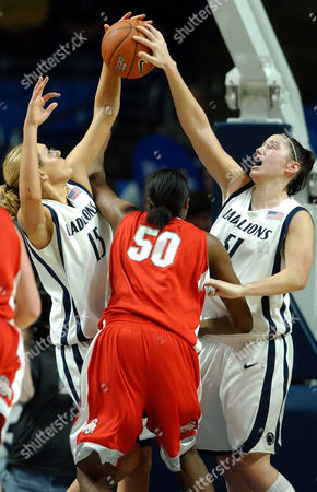 BROWN DAVENPORT SCHWAB Penn State teammates Amanda Brown, left, and Ashli Schwab, right, block a shot put up by Ohio State's Jessica Davenport during the second half of Penn State's 69-92 win in State College, Pa