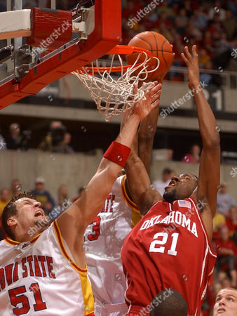 HOMAN GRAY Oklahoma's Taj Gray goes up for a shot against Iowa State's Jared Homan during the first half in Ames, Iowa