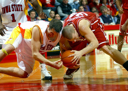 HOMAN BOOKOUT Oklahoma's Kevin Bookout, right, and Iowa State's Jared Homan battle for the ball during the first half in Ames, Iowa. Iowa State beat Oklahoma 74-64