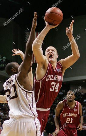 BOOKOUT JONES *{F23CAA4F-B8C6-474D-90DA-333495834636 Oklahoma's Kevin Bookout (34) shoots around Texas A&M's Joseph Jones (30) during the first half in College Station, Texas
