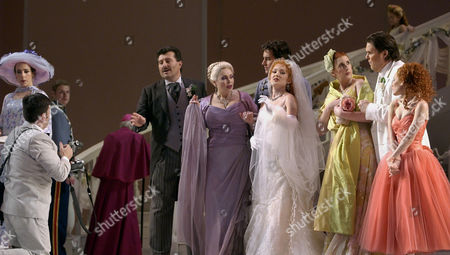 """Stock Photo of CARTER From Left, Maria Kanoyva as Rita Billingsley, Jerry Hadley as Luigi Corelli, Catherine Malfitano as Victoria Sloan Corelli, Patrick Miller as Dino Corelli, Anna Christy as Margaret """"Muffin"""" Brenner Corelli, Lauren Flanigan as Katherine """"Tulip"""" Brenner Mark Delavan as Liam """"Snooks"""" Brenner, and Lauren Carter as Elizabeth """"Buffy"""" Brenner pose for photographs in William Bolcom's operatic version of Robert Altman's 1978 movie """"A Wedding"""" during dress rehearsal at the Lyric Opera of Chicago. The Opera makes its World premire at the Lyric on Saturday, Dec. 11, 2004"""