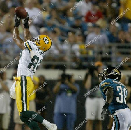 FERGUSON WASHINGTON Green Bay Packers wide receiver Robert Ferguson, left, makes a catch in front of Jacksonville Jaguars' Dewayne Washington during the second quarter, in Jacksonville, Fla