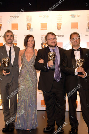 Stock Image of Film not in the english language - Pans Labyrinth. Alfonso Cuaron, Toni Collette which presented the award, Guillermo del Toro and Alvaro Augustin