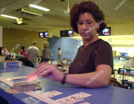 JOHNSON Liz Johnson of Cheektowaga, N.Y., pulls a card from the deck after making a strike in league-play at the Ideal Bowling Center in Buffalo, N.Y. on