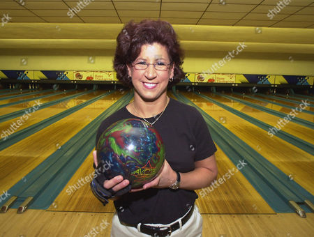 JOHNSON Liz Johnson, of Cheektowaga, N.Y. poses for her portrait in front of the center lanes at the Ideal Bowling Center in Buffalo, N.Y. on . Johnson qualified for the men's PBA Uniroyal Tire Classic in Ohio on Nov. 10, 2004. Johnson was defeated in the first round of the tournament