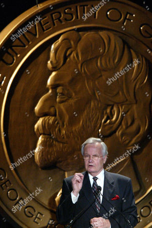 Bill Moyers gestures while accepting the Individual George Foster Peabody award during the 63rd annual Peabody awards luncheon, in New York. Moyers was honored for career achievements, most recently his series 'Now with Bill Moyers' and the documentary 'Becoming American: The Chinese Experience