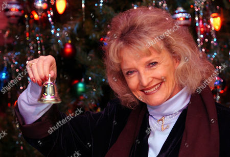 """GRIMES ZUZU Karolyn Grimes, who played Zuzu in the movie """"It's a Wonderful Life,"""" rings her bell at the Lancaster Opera House in Lancaster, N.Y., . She said she had the bell made in honor of Jimmy Stewart, and that it is engraved with the line from the movie """"Everytime a bell rings an angel gets his wings."""" Grimes, now 64, said she's seen the movie so many times she's beyond paying attention to the story and acting and instead focuses on the subtleties others may overlook"""