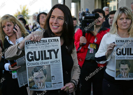 APHRODITE JONES Aphrodite Jones, a crime writer, holds up a special edition of the Redwood City Daily News, after the announcement of a first degree murder verdict in the Scott Peterson case, outside of the courthouse in Redwood City, Calif