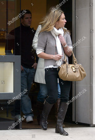 Michael and Louise Owen leaving a shop on Sloane Street
