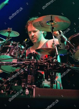 FISHMAN Phish drummer Jon Fishman plays their last song as a band before breaking up early at Phish festival in Coventry, VT