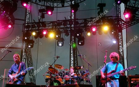 PHISH Phish's Trey Anastasio, left, drummer Jon Fishman, center, and bassist Mike Gordon perform with the band at Keyspan Park in the Brooklyn borough of New York