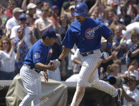 KIM LEE Chicago Cubs Derrek Lee is congratulated by third base coach Wendel Kim after Lee hit a two-run home run in the eighth inning against the Pittsburgh Pirates in Chicago. The Cubs defeated the Pirates 6-1
