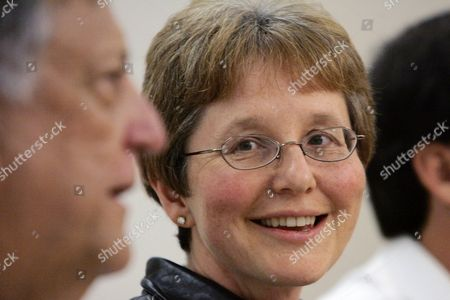 BECKER HEIMBACK Wendy Becker smiles as she looks at Dr. David Heimbach at a news conference, at Harborview Medical Center in Seattle. Becker's son, Matthew Ramige, 29, of Jackson Hole, Wyo. was one of two survivors of a Monday plane crash in the rugged wilderness of northwest Montana who emerged on a highway Wednesday after making their way on foot through the mountains. The survivors, both U.S. Forest Service employees, made their way out a day after both the Flathead County sheriff and the Forest Service had announced their deaths. Three others died in the crash