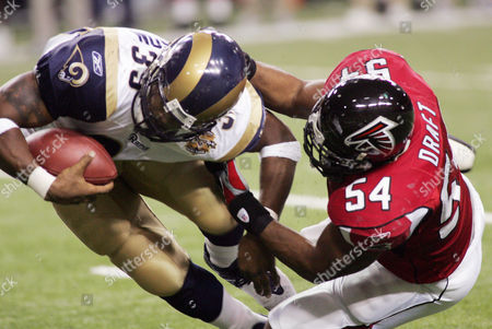 DRAFT St. Louis Rams running back Steven Jackson (39) is brought down by Atlanta Falcons Chris Draft (54) during second half play in the NFC Divisional playoff game at the Georgia Dome in Atlanta on