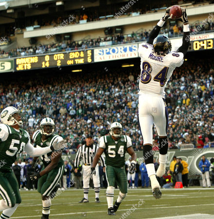 MOORE From left, New York Jets linebackers Eric Barton, Jonathan Vilma and Victor Hobson watch as Baltimore Ravens wide receiver Clarence Moore leaps up to catch a six-yard touchdown pass from quarterback Kyle Boller in the second quarter of the Ravens 20-17 overtime victory over the New York Jets, at Giants Stadium in East Rutherford, N.J