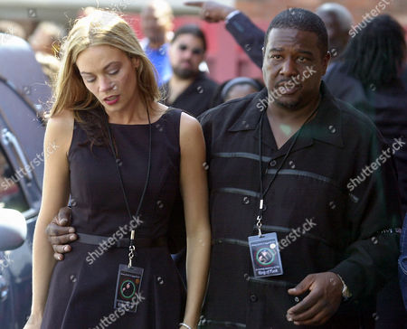 JAMES Tanya Johnson James, left, ex-wife of Rick James, is escorted outside St. John Baptist Church by a member of the Stone City band during Rick James' funeral service in Buffalo, N.Y., on