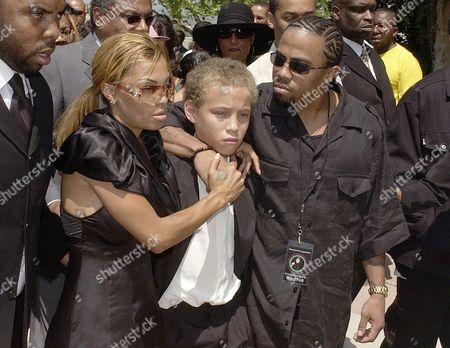 JAMES Ty James, left, Tazman James, and Rick James Jr., right, arrive at the memorial service for their father musician Rick James at Forest Lawn in the Hollywood Hills section of Los Angeles, . James died in his sleep last week at his home near Universal City. He was 56