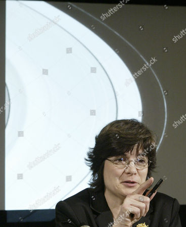 PORCO Carolyn Porco, image team leader, speaks during a news conference, at NASA's Jet Propulsion Laboratories in Pasadena, Calif. The image shown behind her taken by Cassini shows a portion of the rings of Saturn after the successful completion of the orbit insertion