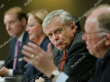 """DONALDSON Securities and Exchange Commission Chairman William Donaldson listens during an open hearing on regulations concerning hedge funds and the so-called """"quiet period"""", at SEC headquarters in Washington, . The oversight agency is proposing to loosen the rules restricting executives' comments in the weeks before their company goes public in a stock sale. They are also mandating new restrictions for hedge funds_ the largely unregulated investment pools traditionally for the wealthy that have become popular with small investors in recent years"""