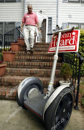 HEARD Georgia State Rep. John Heard walks back to his Segway scooter after knocking on a door while campaigning in a Lawrenceville, Ga., neighborhood . Heard has found he can cover more ground by using a Segway