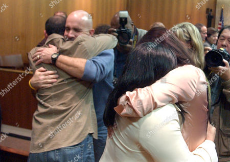 SANCHEZ FOY Julie Sanchez, center right, hugs her daughter, Juanita Kadolph, right, and Joseph Foy, facing camera, hugs John Semander after Coral Eugene Watts, 51, was found guilty of murder, in Pontiac, Mich., in a quarter-century old murder case that authorities believe was the best bet for keeping him off the streets. Watts was convicted in the Dec. 1, 1979 stabbing death of Helen Dutcher, 36, in a Ferndale, Mich., alley. Foy was the key witness in the murder trial and Sanchez was attacked by Watts on the side of a Texas highway more than 20 years ago as she tried to fix a flat tire on her car. Watts slashed Sanchez's throat and left her for dead, but she survived