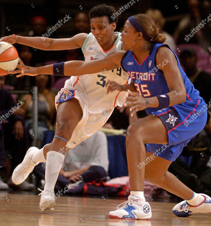 Detroit Shock forward Cheryl Ford, right, tries to steal the ball from New York Liberty forward Crystal Robinson during the first half in New York
