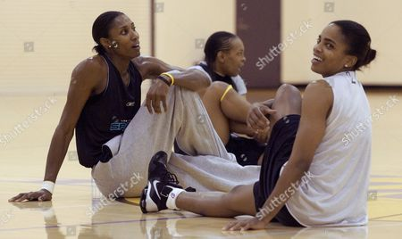 LESLIE DIXON The Los Angeles Sparks' Lisa Leslie, left, Sophia Witherspoon, center, and Tamecka Dixon warm up during a team practice in El Segundo, Calif., . The Sparks overcame many hurdles to finish with the WNBA's best record of 25-9, and now are the top-seeded team going into their playoff opener at Sacramento on Friday night