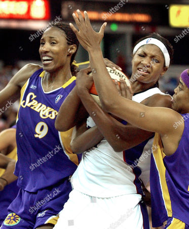 LESLIE WALKER DIXON Los Angeles Sparks center Lisa Leslie, left, and guard Tamecka Dixon, right, battle for control of the ball with Sacramento Monarchs forward DeMya Walker, middle, during the second half in Sacramento, Calif., on . The Sparks won in double overtime, 85-80