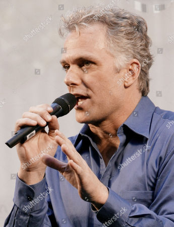 "Patrick Cassidy of the Broadway show ""42nd Street,"" performs during ""Stars In The Alley,"" a free concert by Broadway stars in New York's theater district . The show marks the end of the 2003-2004 theater season"