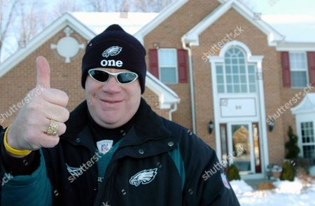 O'DONOGHUE Philadelphia Eagles fan and season ticket holder Kevin P. O'Donoghue gives a thumbs up to the team's chances in the upcoming Super Bowl outside his Glen Mills, Pa. home. Some long-suffering Eagles fans, including O'Donoghue, are so desperate to get to the Super Bowl that they're borrowing against their homes to pay for the tickets