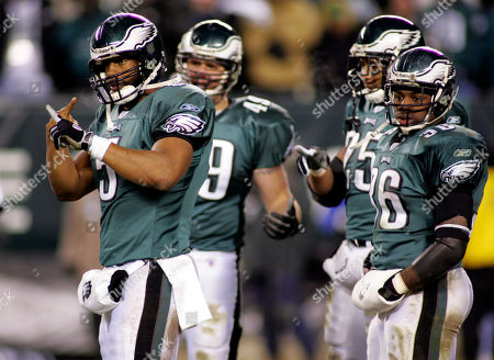 Philadelphia Eagles quarteback Donovan McNabb,left, signals to the sideline during the NFC championship game against the Atlanta Falcons in this photo in Philadelphia. Looking on are Eagles Josh Parry (49), Dorsey Levens (25) and Brian Westbrook