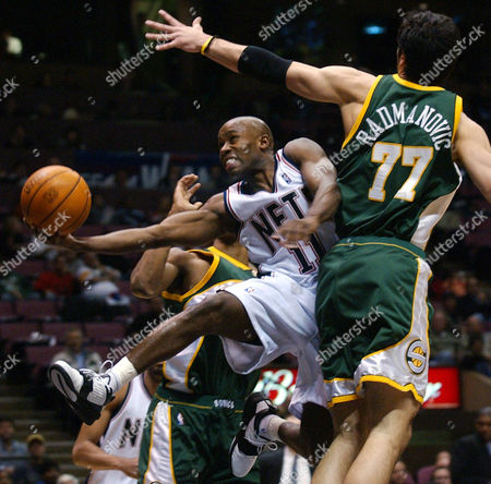 LEWIS VAUGHN RADMANOVIC New Jersey Nets' Jacque Vaughn drives to the basket between Seattle SuperSonics' Vladimir Radmanovic (77) of Serbia-Montenegro and Rashard Lewis, rear, during the second quarter Wednesday night, in East Rutherford, N.J