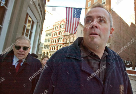 HATCH HOLDEN Richard Hatch, right, with his lawyer Justin Holden, left, leave court after Hatch was released on $50,000 bond in his federal tax evasion hearing, in Providence, R.I. Hatch is charged with filing false tax returns in 2000 and 2001, where he didn't report his $1 million winnings from the reality television series, Survivor, and earnings made from working at a Boston, Mass., radio network, worth $321,000