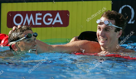 PEIRSOL KRAYZELBURG Aaron Peirsol, right, puts his hand on the head of Lenny Krayzelburg after winning the Men's 100 Meter Backstroke final at the U.S. Olympic swim trials in Long Beach, Calif., . Peirsol won the race with a time of 53.64 and Krayzelburg took second with a time of 54.06