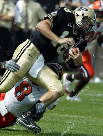 ORTON SMITH Purdue quarterback Kyle Orton, top, is tackled by Syracuse's Kelvin Smith after picking up a first down in the first quarter in West Lafayette, Ind